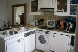 Fully stocked kitchen and washer.